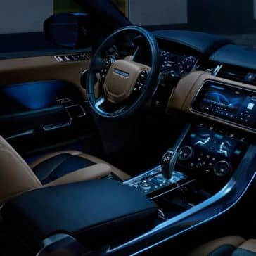 2019 Land Rover Range Rover Sport Interior Front Seating and Dashboard at Night