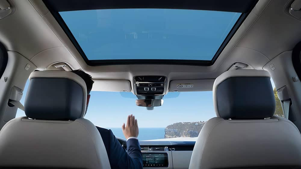 2019 Land Rover Range Rover Interior View of Panoramic Roof with Man using hand gesture