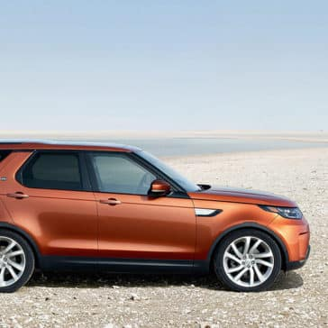 2019 Land Rover Discovery Side Profile Parked at a Beach
