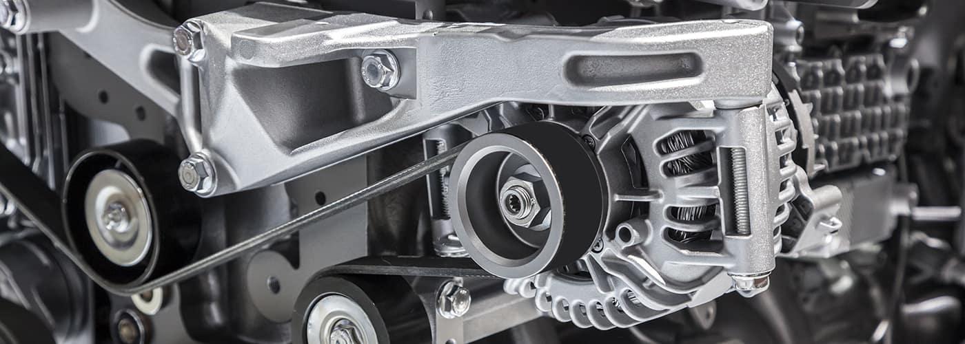 Alternator with flat drive belt at modern truck engine