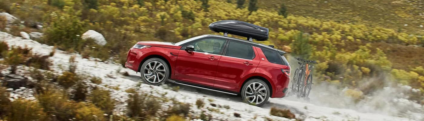 land rover discovery sport red driving off road
