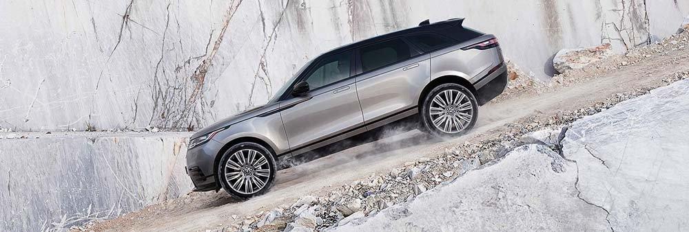 2018 Land Rover Range Rover Velar driving down gravel hill