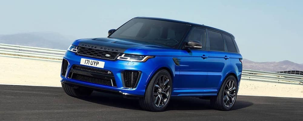 blue 2019-Land-Rover-Range-Rover-Sport-Driving on open road
