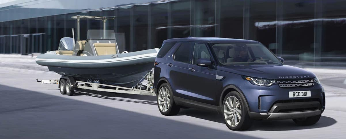 2020 Land Rover Discovery towing a boat