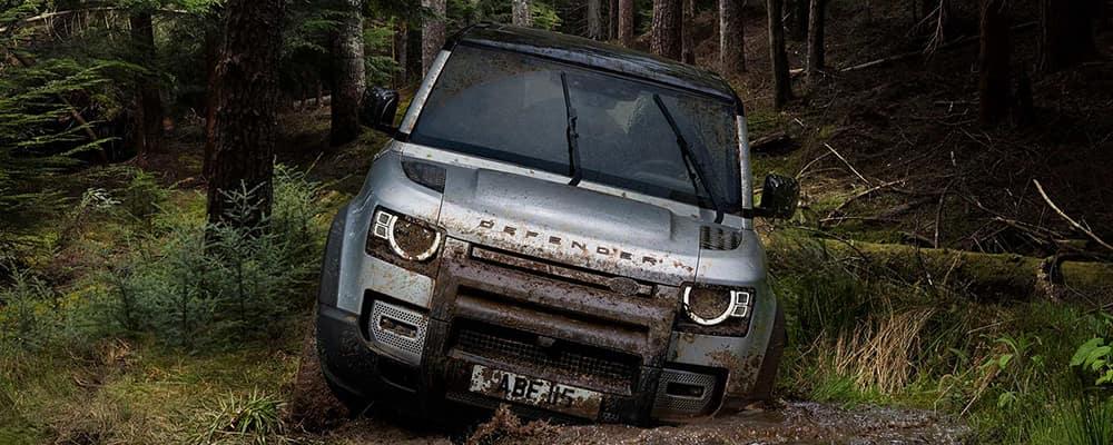 2020 Land rover defender driving through mud