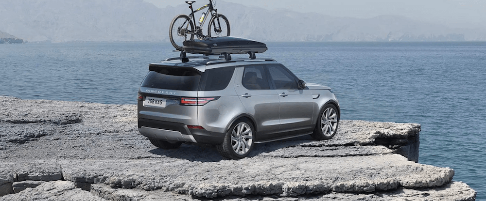 2020 Land Rover Discovery with bike on coastal road