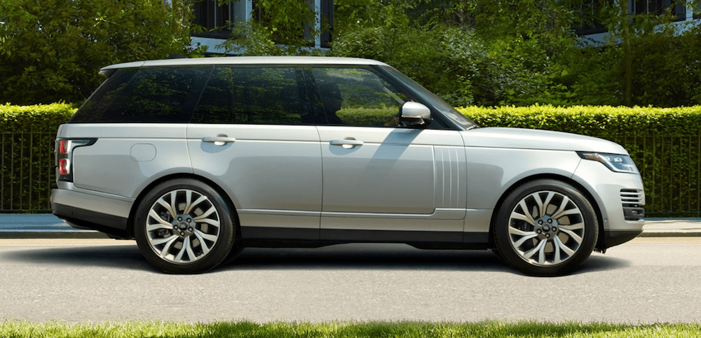 2020 Range Rover driving on suburban road