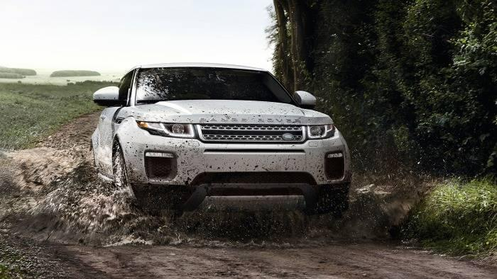 Land Rover Range Rover Evoque driving through a muddy trail