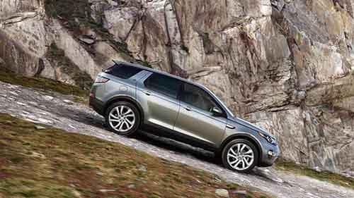2018 Land Rover Discovery Sport driving down gravel hill