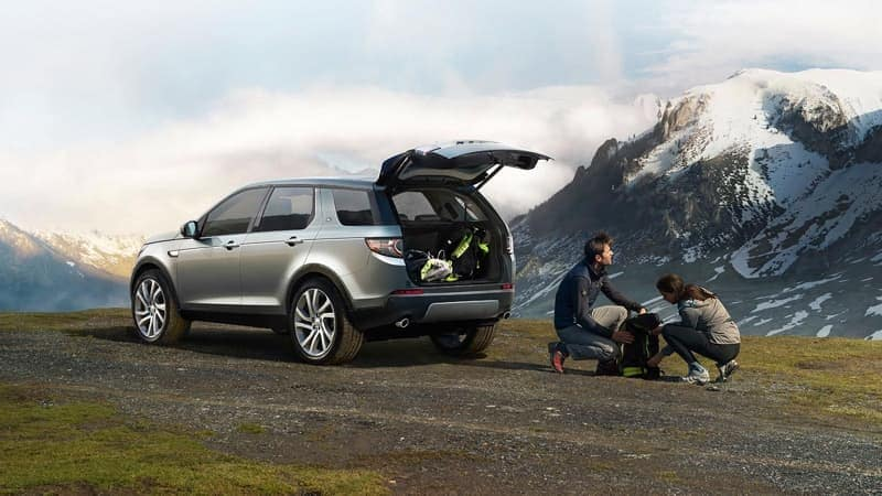 2019 Land Rover Discovery Sport Parked at Mountain with Hikers Getting Ready