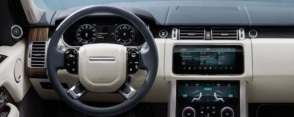 2019 range rover interior view of steering wheel and dashboard