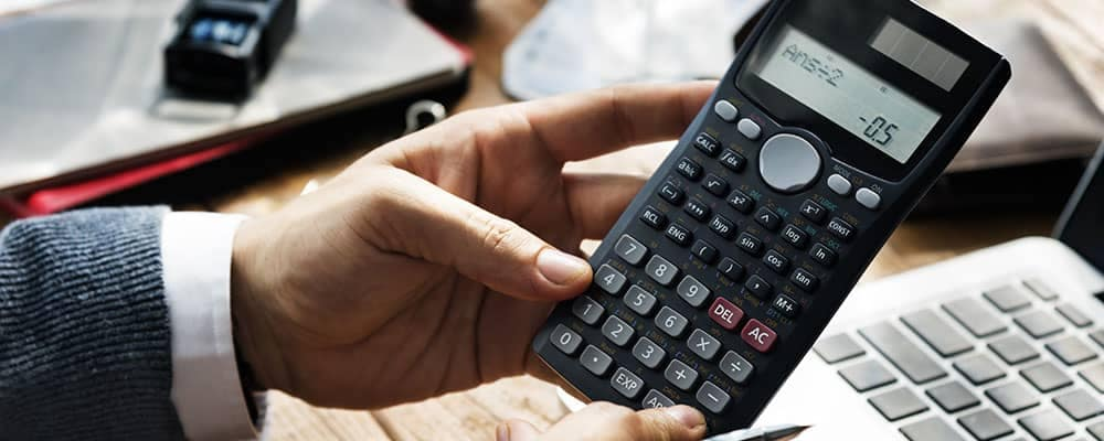 Man holding calculator