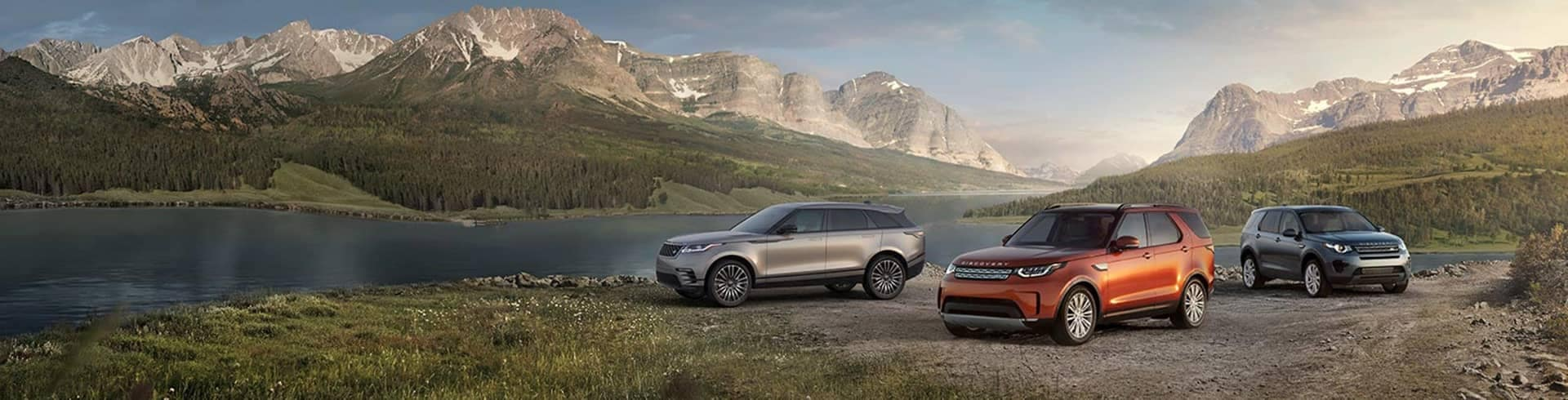 2019 Land Rover vehicles near mountain lake