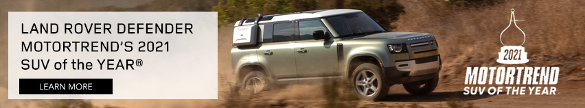 Land Rover Defender on dirt road SUVOTY