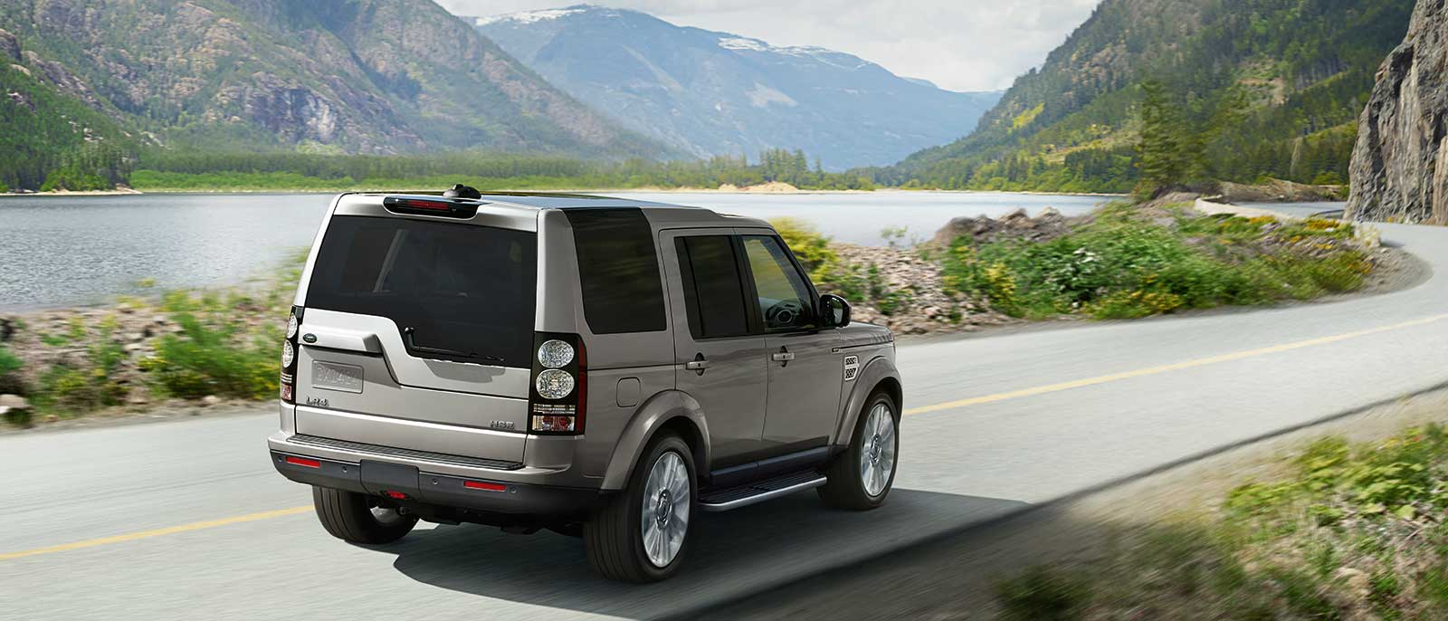 2016 Land Rover LR4 rear view; driving past mountains