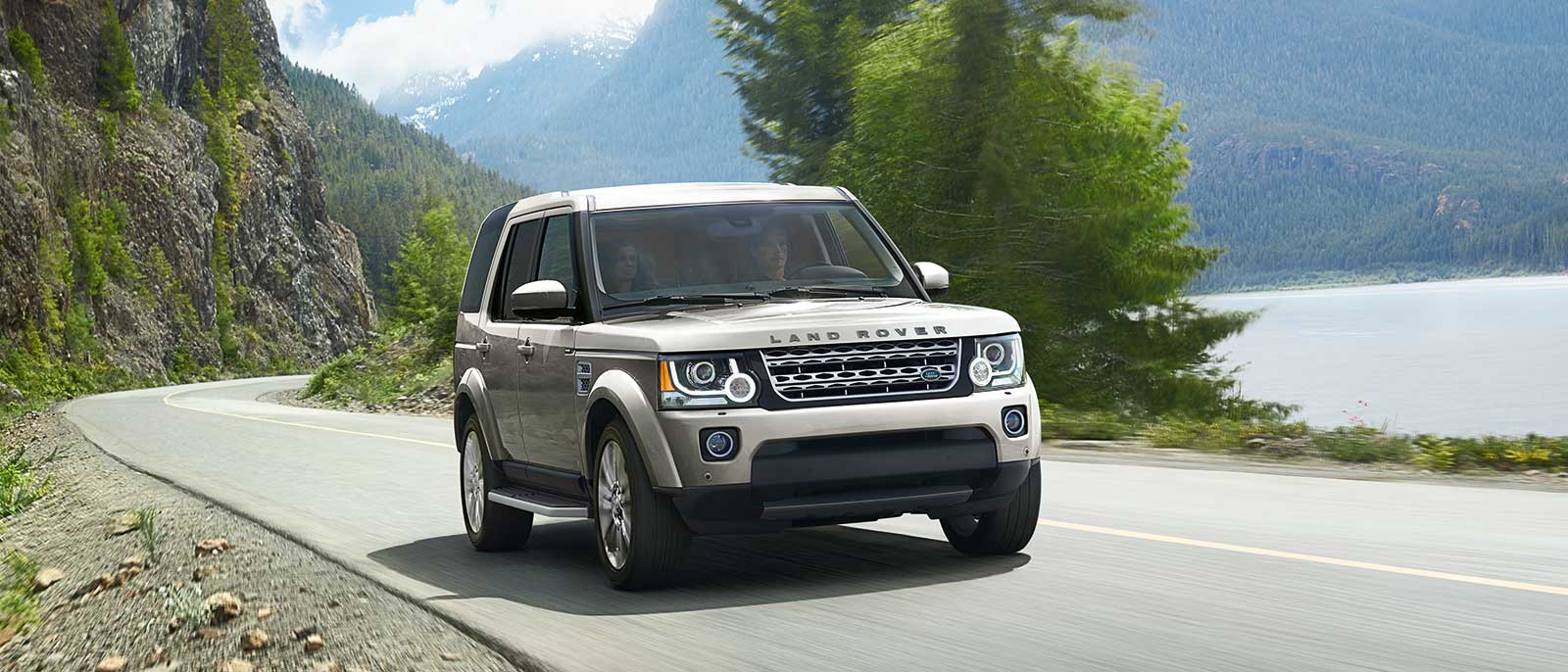 2016 Land Rover LR4 driving through forest
