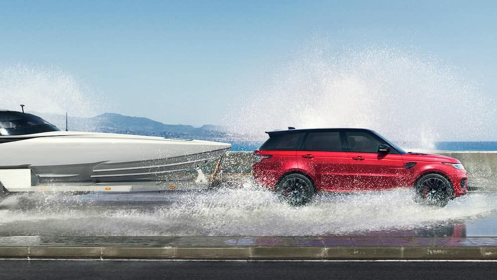 2019 Land Rover Range Rover Sport towing a boat