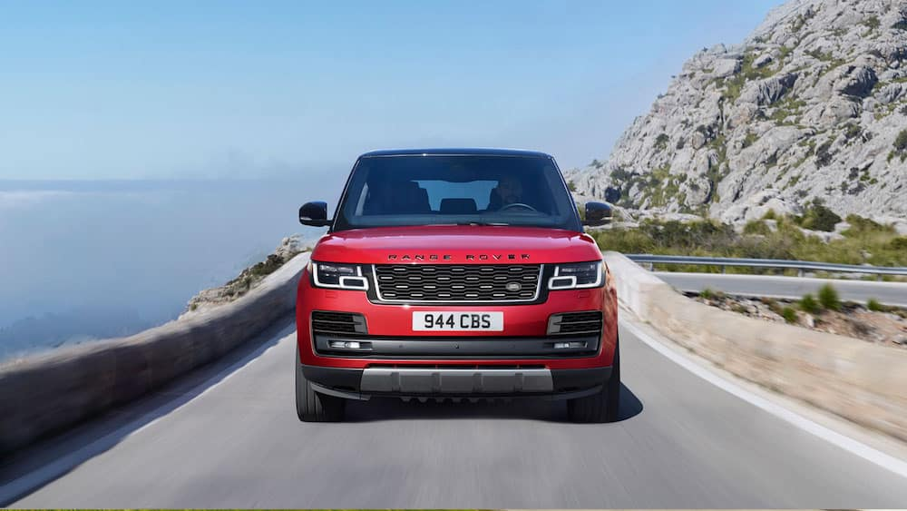 2019 Range Rover in red on a mountain road