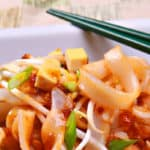 plate of tofu pad thai with chopsticks