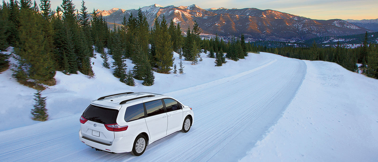 2016 Toyota Sienna in the snow, rear view