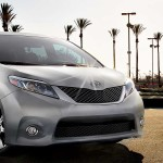 2016 Toyota Sienna surrounded by palm trees; front view