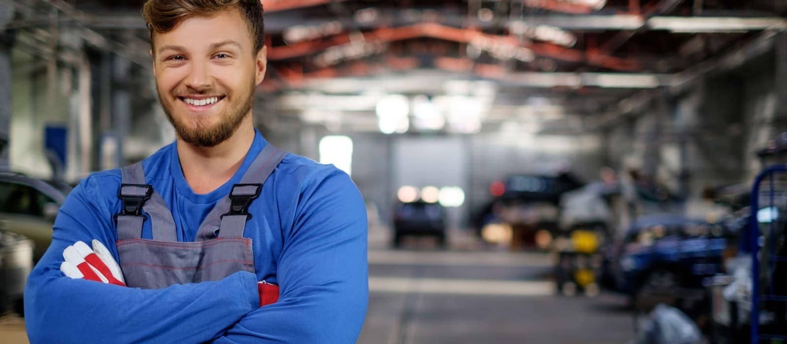 mechanic smiling in service department