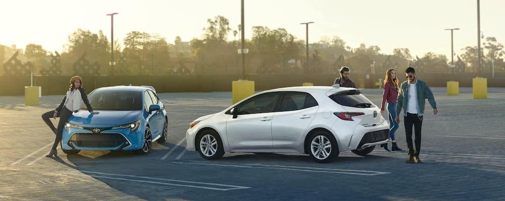Toyota Corolla vehicles in a parking lot with people