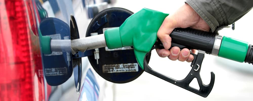 Person pumping gas into car