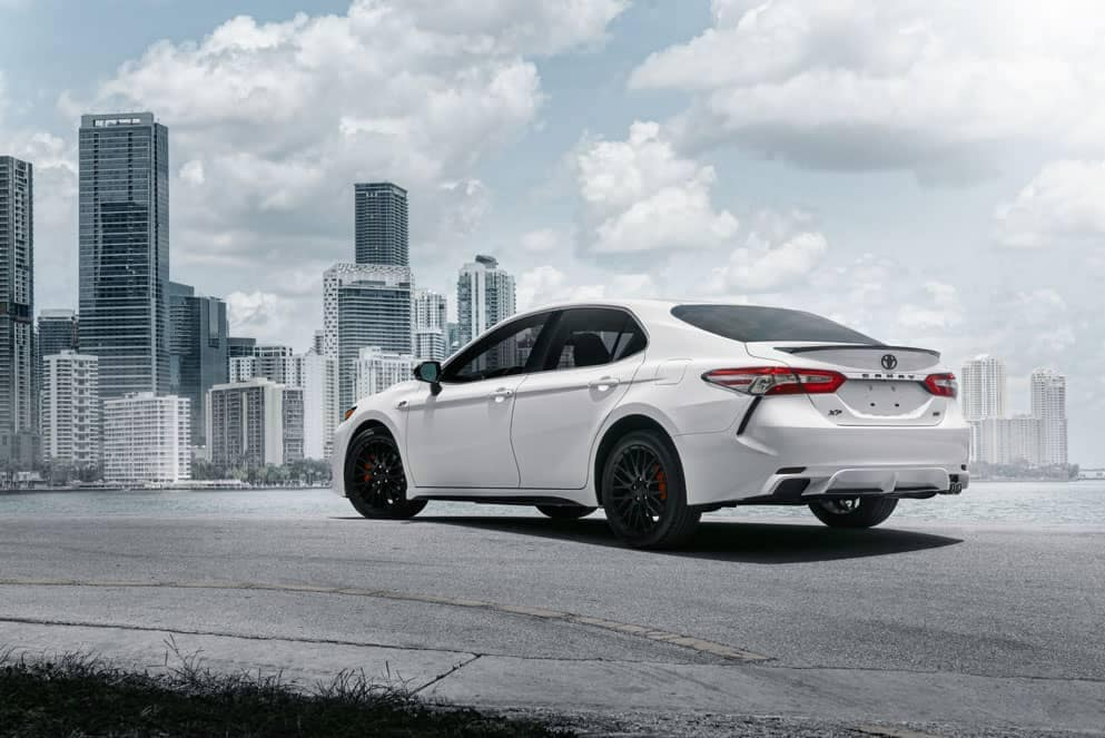 Toyota Camry XP rear in front of city
