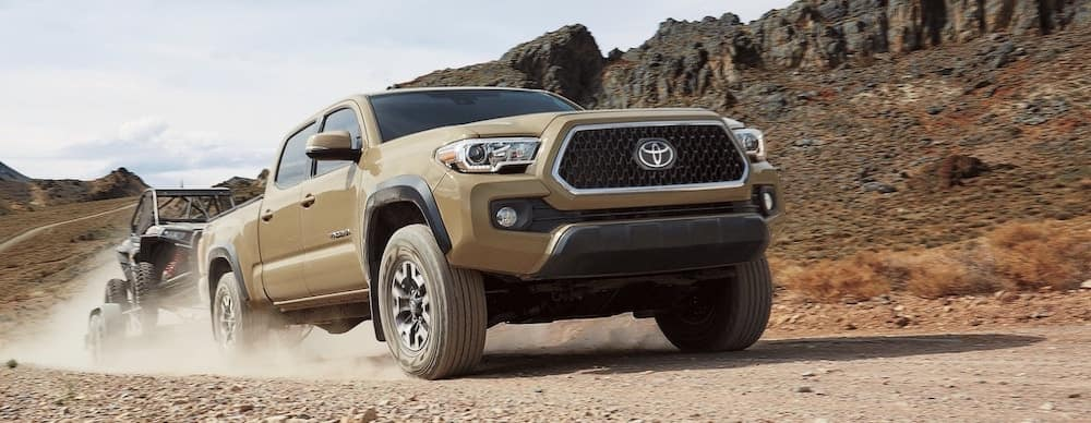 2019 Toyota Tacoma V6 towing in a desert landscape