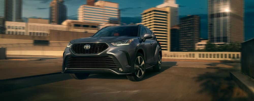 2021 Toyota Highlander driving away from city