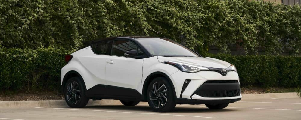 2021 Toyota C-HR parked next to a ivy wall