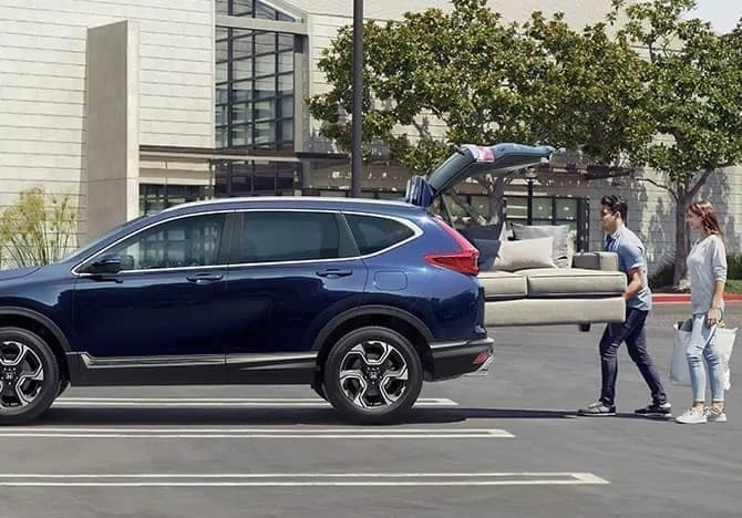 man putting couch into 2019 Honda CR-V