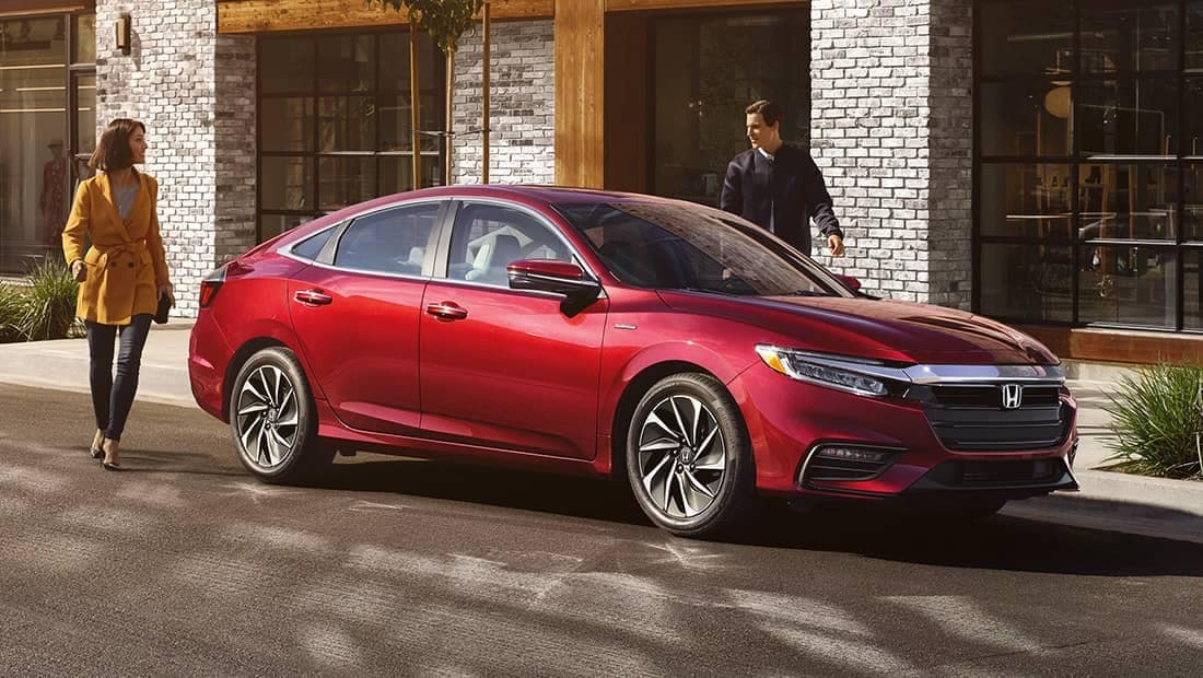 couple walking to 2020 Honda Insight