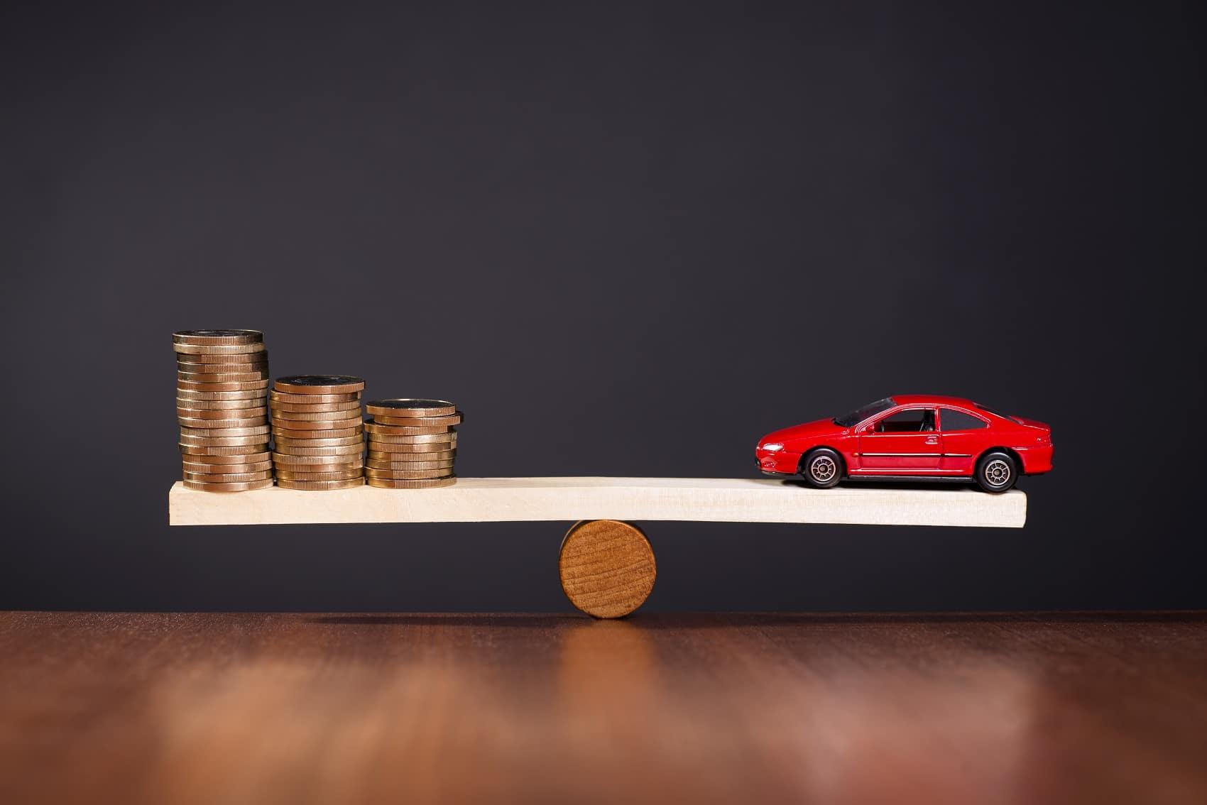 Money balancing out a car