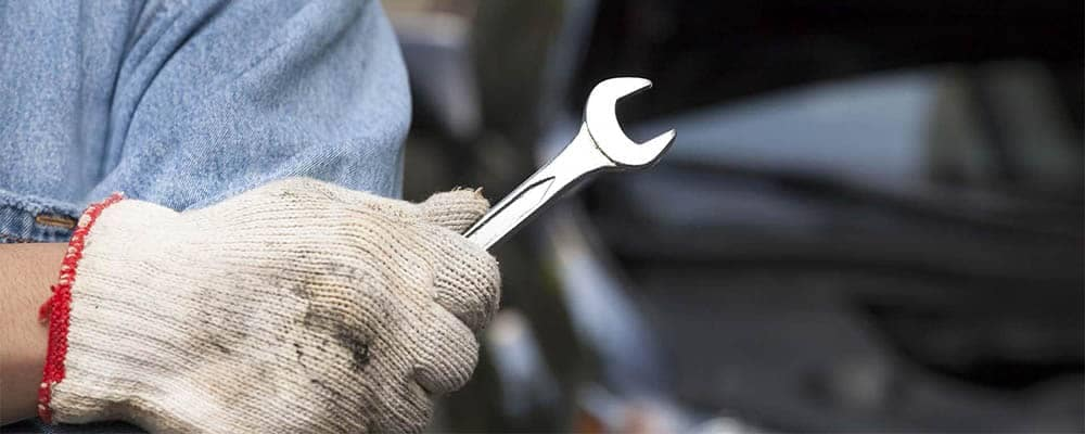 Service Mechanic Holding Wrench