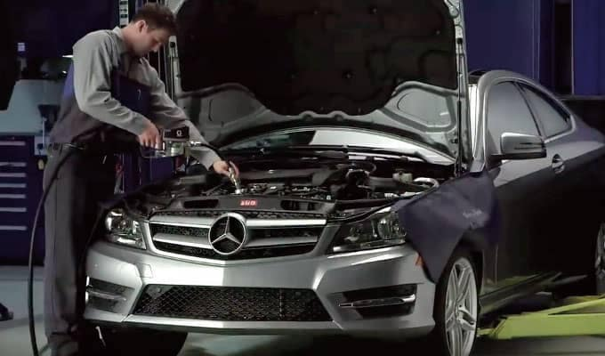 Mechanic Filling Oil Mercedes-Benz