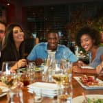 Friends dining in a restaurant_50473983_original (1)