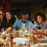 Friends dining in a restaurant_50473983_original (1)
