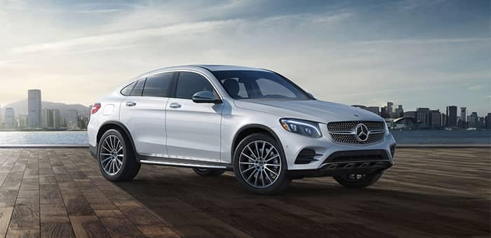 2019 Mercedes-Benz GLC Coupe Parked by Water with City in Background