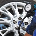 close up of man checking tire pressure