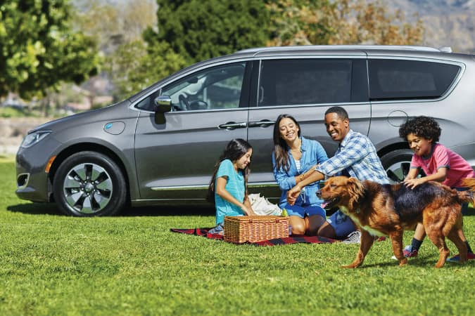 A family on a picnic in their Chrysler Pacifica