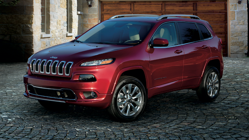 A red 2019 Jeep Cherokee parked in a driveway