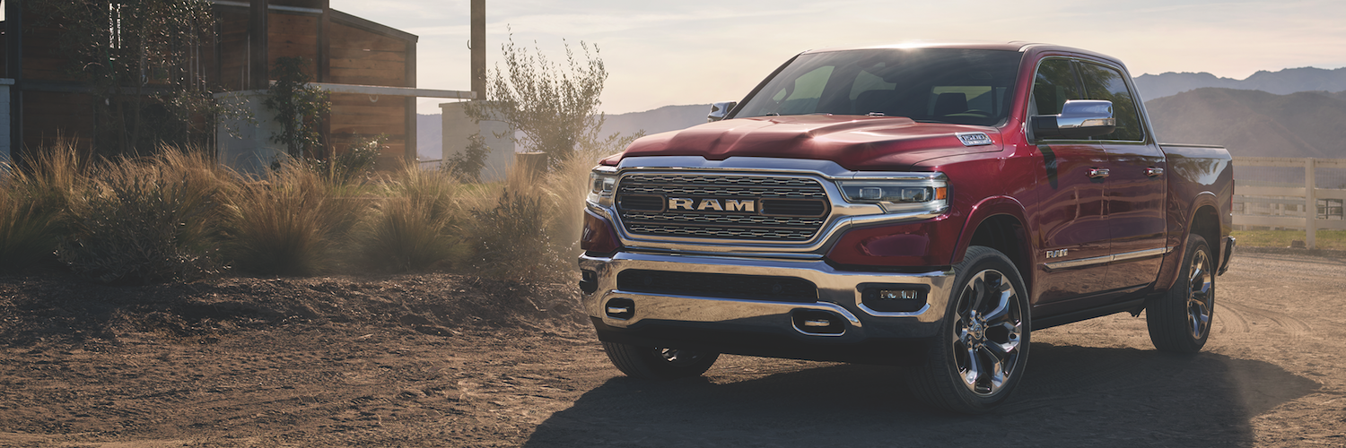 A red 2019 Ram 1500 on a farm