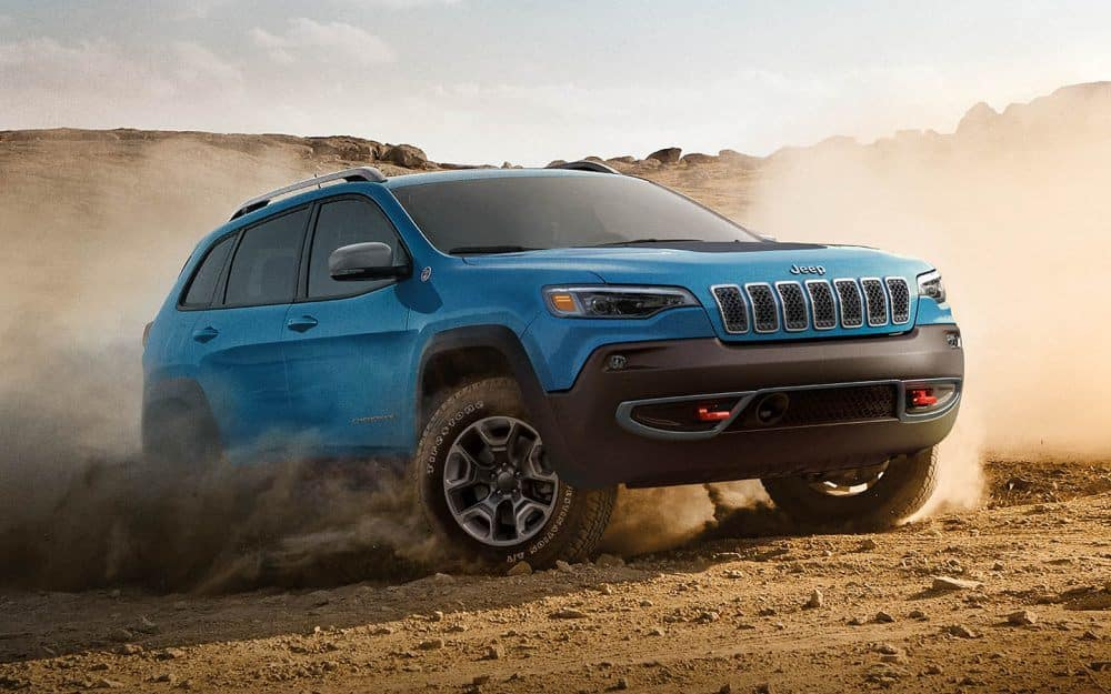 A blue Jeep Cherokee going off roading