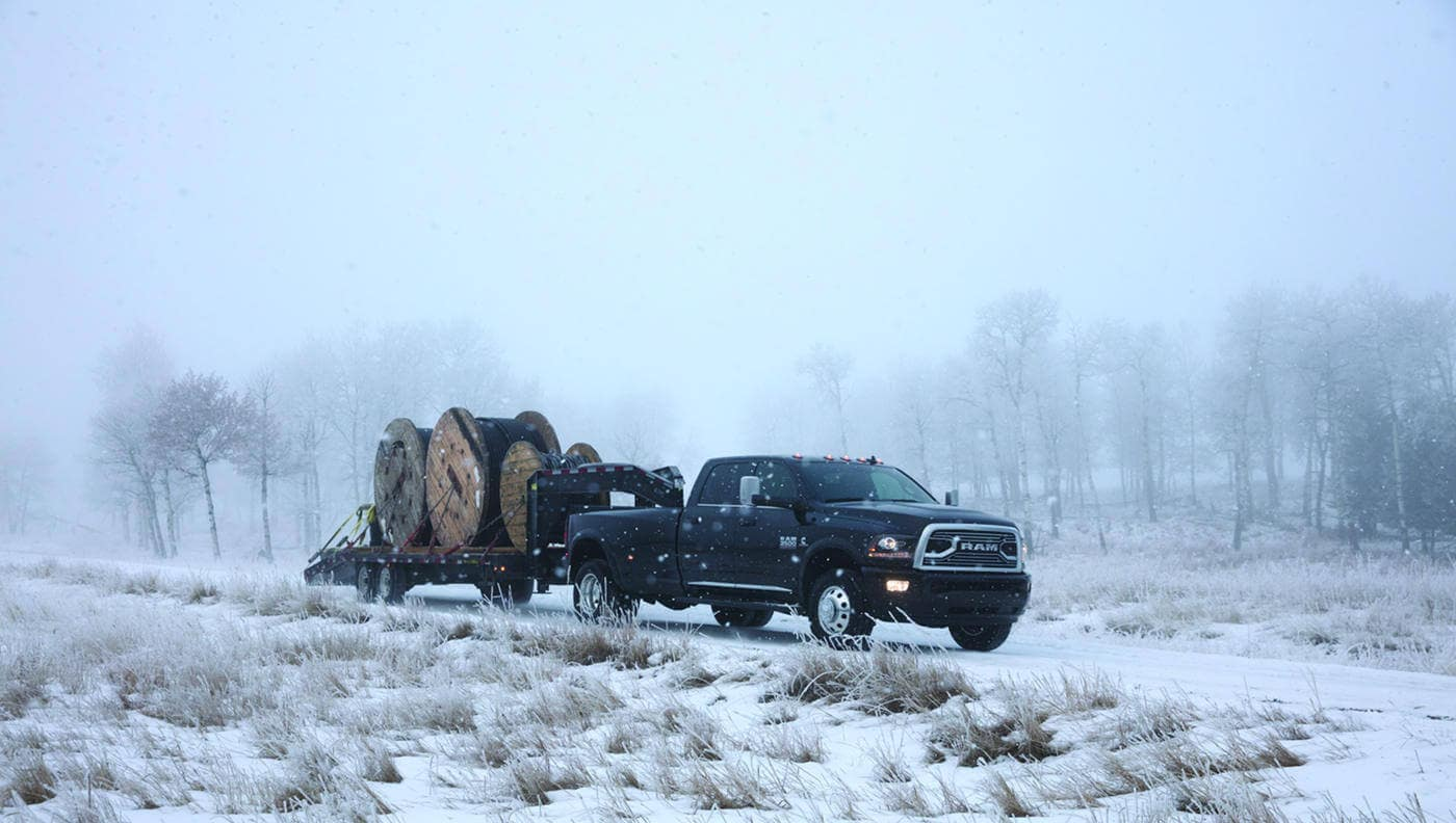A 2018 Ram 3500 towing heavy equipment