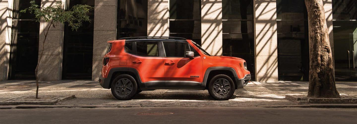 An orange Jeep Renegade Parked on the street