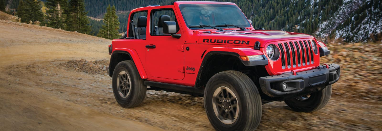 2019 Jeep Wrangler Trim Levels Sport Vs S Sahara Jk Brake Controller Wiring Diagram A Red Rubicon Driving Down Dirt Road