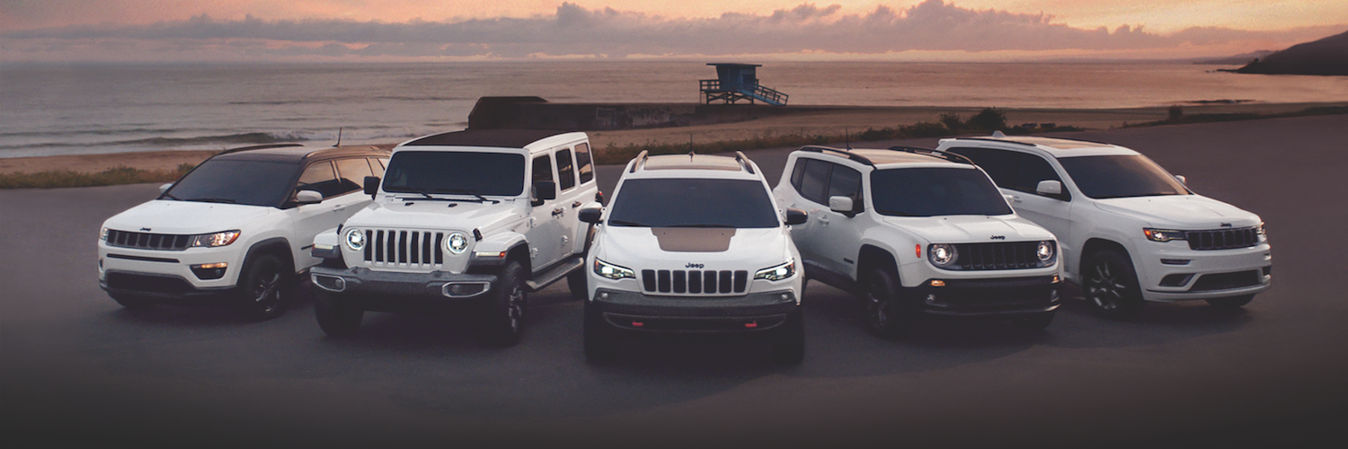 An all white Jeep model lineup infront of a sunset