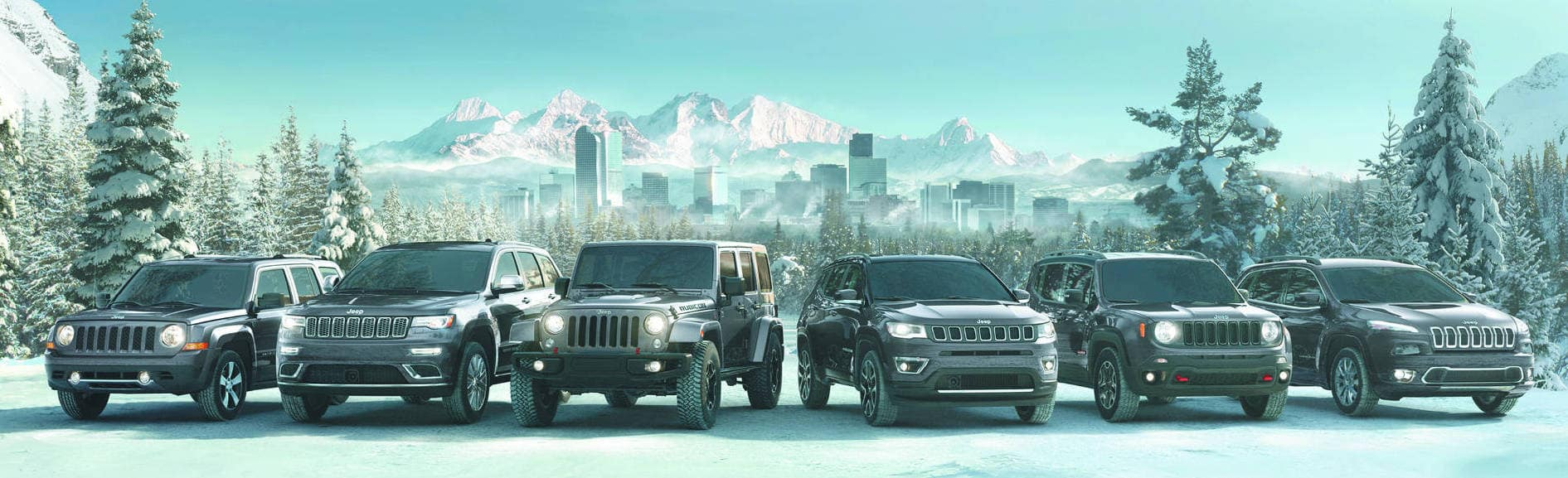 An all white Jeep model lineup infront of a Mountain